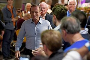 "Former Australian Prime Minister Tony Abbott, the self-described ""junkyard dog"" of Australian politics, lost his seat in Sydney."