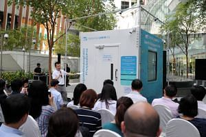 Mr Stefen Choo, director of Southern Globe Corporation, speaking at the launch of the smoking cabin outside Fusionopolis.