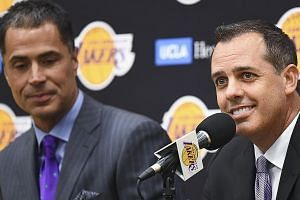 New Los Angeles Lakers head coach Frank Vogel (right, with general manager Rob Pelinka) believes that forging a sense of unity would be crucial as he attempts to halt six years of not making the NBA play-offs. PHOTO: REUTERS