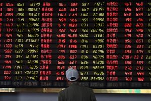 Investors monitor stock price movements at a securities company in Shanghai on May 8, 2019.