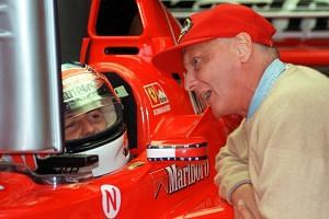 German Ferrari driver Michael Schumacher (left) chats with former Austrian Formula One driver Niki Lauda during a training session of the Austrian Formula One Grand Prix at A1 circuit in Spielberg, Austria, on July 25, 1998.