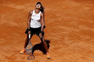 Japan's Naomi Osaka reacting after a poor shot during her second-round match against Slovakia's Dominika Cibulkova at the Italian Open earlier this month. Osaka won 6-3, 6-3 but she had to withdraw from her quarter-final match against the Netherlands