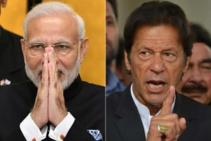 Pakistani Prime Minister Imran Khan (right) congratulated Indian Prime Minister Narendra Modi on the win by the BJP, which has long taken a strong anti-Pakistan stance.