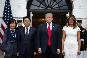 US president Donald Trump and first lady Melania Trump welcome Japanese prime minister Shinzo Abe and his wife Akie Abe outside the South Portico at the White House in Washington on April 26, 2019.