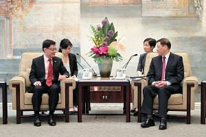 Singapore Deputy Prime Minister Heng Swee Keat meeting Shanghai mayor Ying Yong at the Xijiao State Guesthouse in the city, ahead of the inaugural Singapore-Shanghai Comprehensive Cooperation Council Meeting on May 24, 2019.