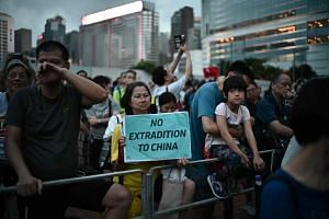 Activists attend a protest in Hong Kong on April 28, 2019, against a controversial move by the government to allow extraditions to the Chinese mainland.