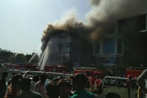 Television channels said some people had jumped off the building in the western city of Surat to escape from the fire.