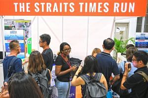 Runners signing up for the 2019 The Straits Times Run at the Osim Sundown Marathon Expo at Marina Bay Sands Expo and Convention Centre Hall C yesterday. Those who sign up by June 16 for the individual 3.5km (originally $50), 10km ($60) and 18.45km ($