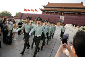 Paramilitary officers marching in formation in Tiananmen Square in Beijing, on May 16, 2019.