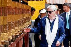 US Ambassador to China Terry Branstad in Lhasa, Tibet, last week, where he met Chinese government officials and Tibetan religious and cultural figures. It was the first such trip by a US ambassador since 2015. PHOTO: AGENCE FRANCE-PRESSE