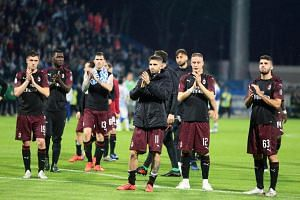 AC Milan players applaud fans after the Italian Serie A soccer match against SPAL Ferrara in Ferrara, Italy, on May 26, 2019.