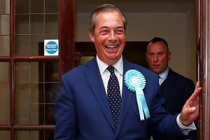 Brexit Party leader Nigel Farage speaks with the media outside the counting centre for the European Parliamentary election in Southampton, on May 26, 2019.