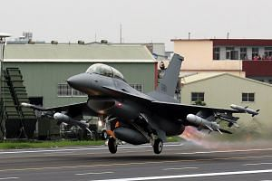 A fighter jet takes off from a highway during an emergency take off and landing drill in Changhua, Taiwan, on May 28, 2019.