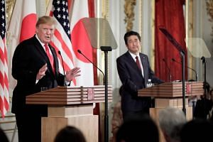 US President Donald Trump (left) speaks during a joint press conference with Japan's Prime Minister Shinzo Abe at Akasaka Palace in Tokyo, on May 27, 2019.