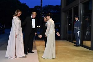 US President Donald Trump (second, left) and US First Lady Melania Trump (left) are greeted by Japan's Emperor Naruhito (centre) and Empress Masako (right) upon their arrival at the Imperial Palace for a state banquet in Tokyo, Japan, on May 27, 2019