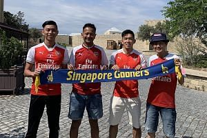 Top, from left: Arsenal fans Tan Si Han, Shaiful Ali Abdul Rahman, Teng Zhi Yan and Leo Sang Fong are in Baku, Azerbaijan, for the Europa League final between Arsenal and Chelsea. PHOTO COURTESY OF SHAIFUL ALI ABDUL RAHMAN Above: Liverpool fans, incl
