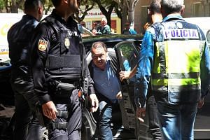 Huesca president Agustin Lasaosa getting out of a car after his arrest yesterday by Spanish police investigating an alleged match-fixing ring in the Spanish football leagues. PHOTO: EPA-EFE