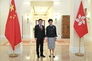 Deputy Prime Minister Heng Swee Keat with Hong Kong Chief Executive Carrie Lam at the Government House in Hong Kong on May 29, 2019.