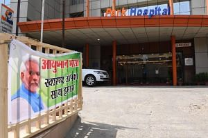 A banner for Ayushman Bharat, commonly known as the Modicare healthcare scheme, is pictured at Park Hospital in Gurgaon.