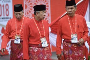 (From left) Umno secretary-general Annuar Musa, Datuk Seri Ahmad Zahid Hamidi, who was forced to go on leave as party president last December, and acting chief Mohamad Hasan at last year's Umno General Assembly at the Putra World Trade Centre.