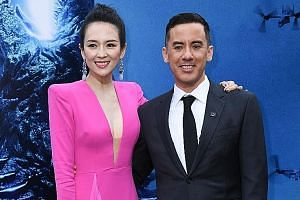 Godzilla II King Of The Monsters director and co-writer Michael Dougherty - with actress Zhang Ziyi, who plays a scientist in the movie - is a lifelong Godzilla obsessive who has loaded his film with references to the original Japanese works.