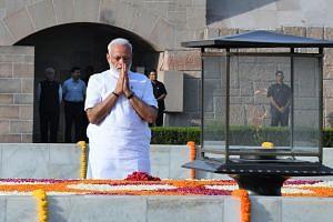 India's Prime Minister-designate Narendra Modi pays tribute at Mahatma Gandhi's memorial in New Delhi on May 30, 2019.