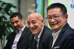 (From left) Authors Ravi Vig and Karl LaRowe and moderator Tan Ooi Boon during the Q&A session at the Straits Times Book Club held at the National Library on May 29, 2019.