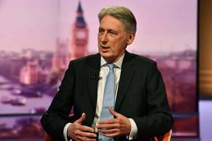 British finance minister Philip Hammond warned those in his party that a no-deal Brexit would threaten the United Kingdom's cohesion.