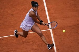 Japan's Naomi Osaka in action during the French Open women's singles second round match against Belarus' Victoria Azarenka (not pictured) in Paris on May 30, 2019.