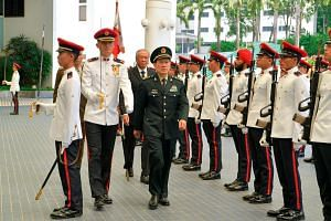 China's Defence Minster Wei Fenghe inspects a guard of honour during a welcoming ceremony at the ministry of defence in Singapore, on May 29, 2019.