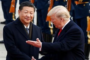 US President Donald Trump with Chinese President Xi Jinping in Beijing in 2017. Some analysts hypothesise that some officials in the Trump administration would not be unduly bothered if there is no trade deal with China.