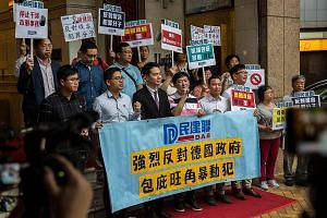 The Democratic Alliance for the Betterment and Progress of Hong Kong, the largest pro-Beijing party in the city, protesting this week outside the German consulate against Berlin's decision to grant refugee status to pro-democracy activists Ray Wong a