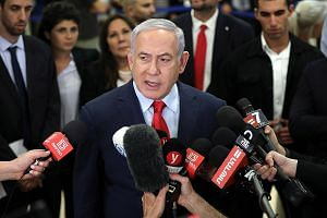 Israeli Prime Minister Benjamin Netanyahu speaking to the press after pushing through a motion for the Knesset to dissolve itself in a dramatic vote, calling for new elections on Sept 17. It is one of the worst government crises in Israel's history.