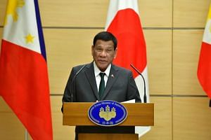 Philippines' President Rodrigo Duterte delivers a speech during a joint press statement with Japan's Prime Minister Shinzo Abe (not pictured) in Tokyo on May 31, 2019.