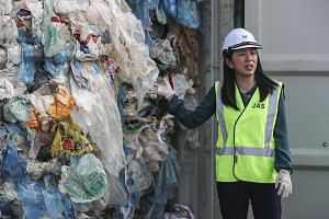 Malaysian Environment Minister Yeo Bee Yin showing the plastic waste inside a cargo container - which was due to be sent back to the country of origin - in Port Klang, Selangor, on Tuesday. She said a total of 3,000 tonnes of plastic waste from some