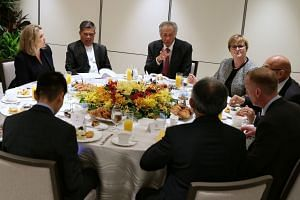 Singapore's Defence Minister Ng Eng Hen (centre) hosted the meeting at the Shangri-La Hotel for (from left) Britain's Secretary of State for Defence Penny Mordaunt, Malaysia's Defence Minister Mohamad Sabu, Australia's Defence Minister Linda Reynolds