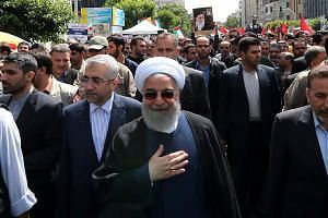 Rouhani attending a parade marking al-Quds (Jerusalem) International Day in Teheran on May 31, 2019.