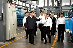 Chinese President Xi Jinping visiting a rare earth processing facility in Ganzhou, Jiangxi province, last month. Also present was Vice-Premier Liu He (in the background, wearing black). Many see the visit as a signal that if Washington does not back