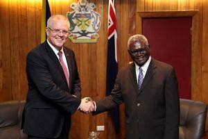 Australia's Prime Minister Scott Morrison (left) shakes hands with Solomon Islands' Prime Minister Manasseh Sogavare before their talks.