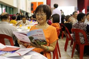 Madam Patricia Tee, 64, a former construction worker who received her welcome package at Chong Pang Community Club.