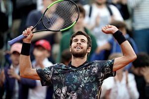 Russia's Karen Khachanov celebrates after winning against Argentina's Juan Martin del Potro at the end of their men's singles fourth round match on day nine of The Roland Garros 2019 French Open tennis tournament in Paris on June 3, 2019.