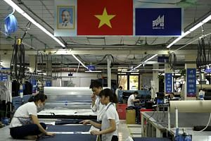 Garment factory workers working in a factory in Hanoi on May 24, 2019.