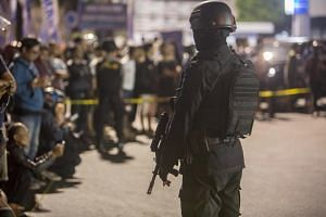 An Indonesian policeman stands guard shortly after a suicide bomber attack in Central Java, Indonesia on June 3, 2019.