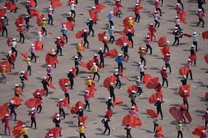 Participants attend a rehearsal understood to be for a 'mass games' performance in Pyongyang on April 12, 2019.