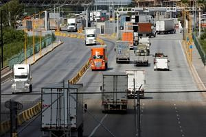 Trucks crossing the border between the United States and Mexico. US lawmakers have urged president Donald Trump to abandon his plan to levy 5 per cent tariffs on all Mexican imports.
