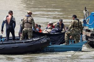 A rescue team continues its search after a tourist boat accident in the Danube river in Budapest.