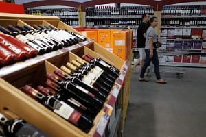 Bottles of wine from US and other countries sit on shelves at a super market in Beijing, China, on June 1, 2019.