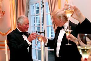Britain's Prince Charles and US President Donald Trump at a dinner at Winfield House in London on June 4, 2019.