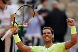 Nadal celebrates after defeating Japan's Kei Nishikori.