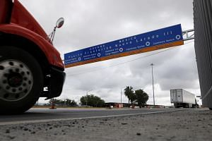 Trucks arriving at a border customs control to cross into the US at the World Trade Bridge in Nuevo Laredo, Mexico on June 5, 2019.